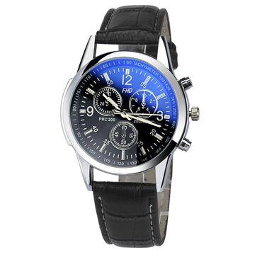 Novi muški sat sa crnom narukvicom. Dužina narukvice sa kućištom 24cm