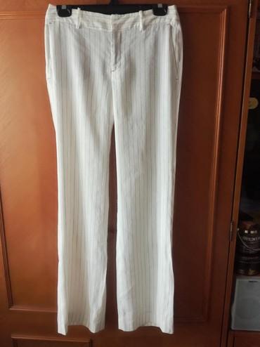 Slonova kost - Srbija: Zara lanene pantalone.Broj 36.Boja je slonove kosti sa tankim svetlo