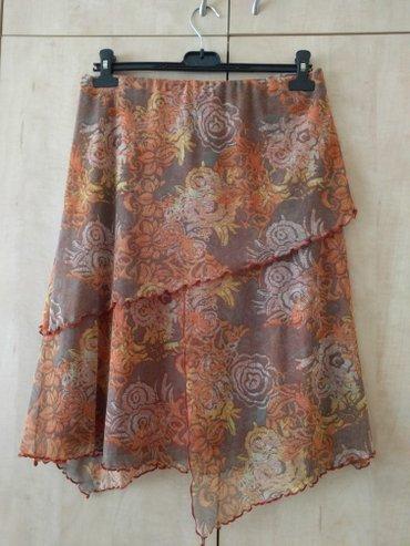 Mexx suknja sa podstavom, interesantnog kroja M veličine. Kliknite na - Palic