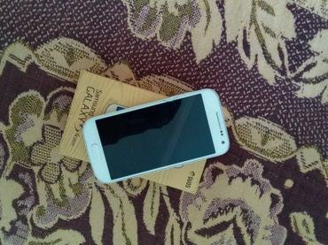 Bakı şəhərində Samsung Galaxy S4 mini,Telefonun platasinda prablem var ve üst
