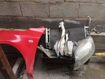Мазда демио. Крыло фара левое радиатор кондицанера бочок амывателя и в Бишкек