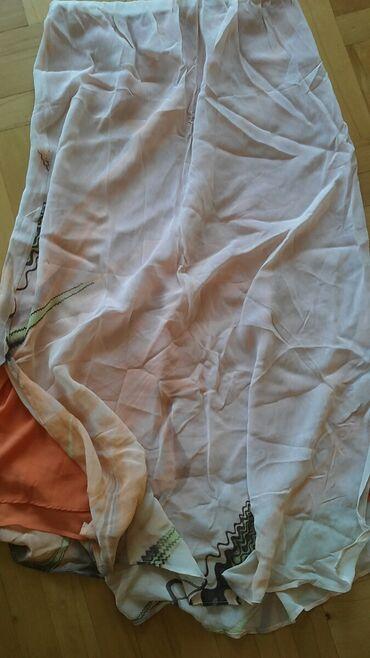 Duga dvosjojna suknja leprsava boja joj je kajsijasta L velicina nova