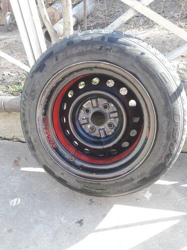 куплю диски на 14 в Кыргызстан: Продаю разварки R 14 185/65 4×100 разноширокие резина летняя. стояли