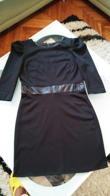 Crna haljina .ima elastina.vel 40.duzina cele 95. - Jagodina