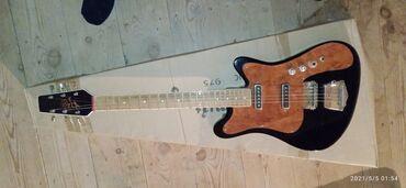 48 elan   İDMAN VƏ HOBBI: Salam bu gitar mənə Amerikadan özəl olaraq hədiyyə olunub.Gitar