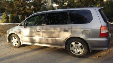 хонда одиссей 2001 г. 2. 3. куб бензин. цвет серый,мотор каропка ходов в Токмак