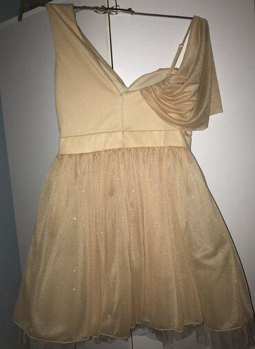 Mnml majica hit - Srbija: Hitno prodajem haljinu, snizena. Placena 9900.Velicina 40.Cena nije