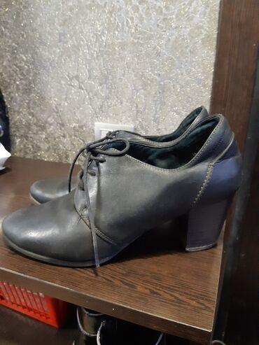 Продаю кожанные фирменные женские ботинки в хорошем состоянии. 41
