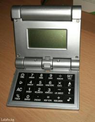 Настольный калькулятор с будильником. в Лебединовка