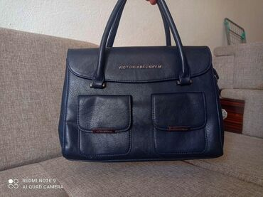 405 объявлений: Продается дамская сумка. Цвет: темно-синийСостояние: новая, ни разу не
