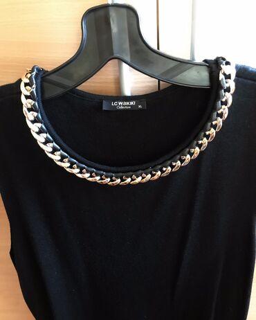Prelepa crna LC WAIKIKI haljina,sa zlatnim ukrsom sa obe strane.Nova