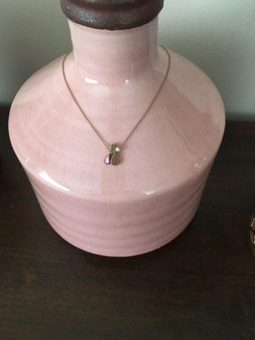 Κρεμαστό ροζ χρυσό Αννα-Μαρια Μαζαρακη.Συμβολιζει μητερα και κορη.Εχει