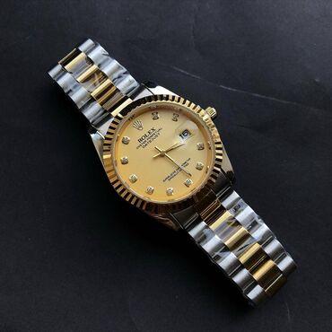 купить золотые часы в бишкеке in Кыргызстан   АВТОЗАПЧАСТИ: Бренд Rolex   • Кварцевый механизм • Индикатор даты • Металлический ко