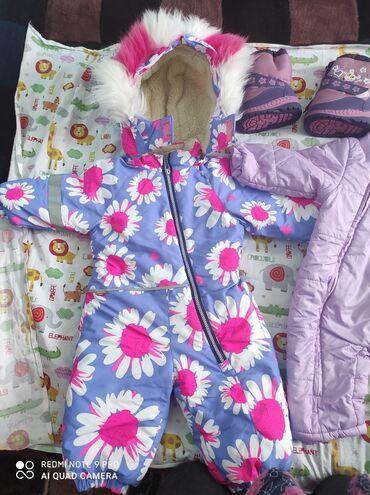 Детский мир - Буденовка: Продаю комбинезон зимний и Деми сезон подарка к нему пакет вещей