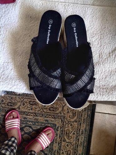 Prodajem nove papuce crne br.39 i italijanske nove farmerke odlicne