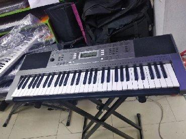 Sintezator Yamaha par 323