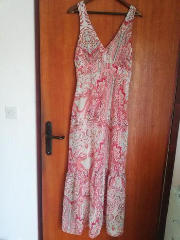 Prodajem dugu letnju haljinu 42 velicina. Duzina 147cm,poluobim ispod