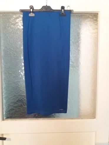 ..NOVO...Suknja....plava..interesantna...duzina 69 cm.Poliester i - Bor