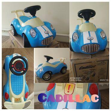 Толокар Cadillac от 1-4 лет в отличном состоянии отдам не дорого