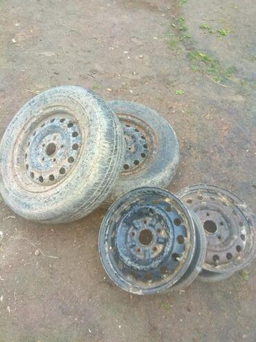 Шины и диски в Кызыл-Суу: Диски R14,4 штуки меняю на титан диски