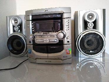 Динамики и музыкальные центры в Нарын: Муз.центр LG. 3 VIDEO CD changer. MP3 CD-R/RW, PHONES, MIC. 2TAPE