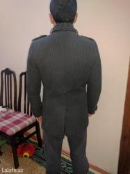 Bakı şəhərində Pol palto satilir. Bedene oturandi.