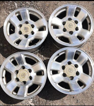 литые диски r16 в Кыргызстан: $200 Оригинальные литые диски R16 с Toyota Hilux surf 185Сверловка