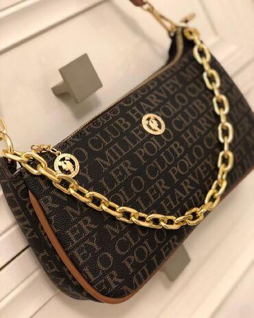 Супер стильная и очень удобная миниатюрная сумочка. Имеется два