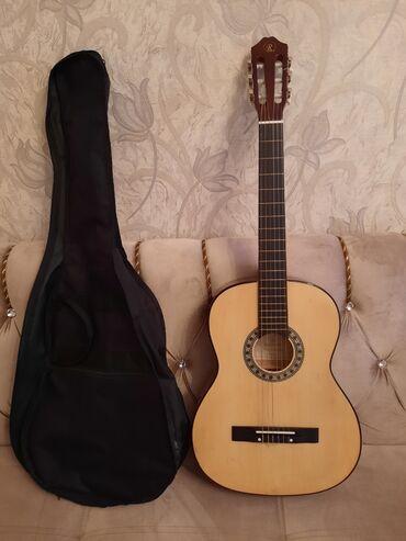 uşaqlar üçün uzunqol futbolkalar - Azərbaycan: Gitara satılır! Gitaranın heç bir problemi yoxdur. Çatığı qırığı
