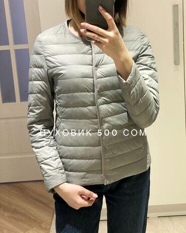Наполнитель - натуральный пух, очень тёплая, можно носить под пальто