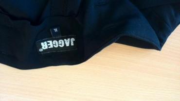 Rasprodaja!! Jagger crne pantalone na ivicu,broj xl,ne guzvaju se - Pozega