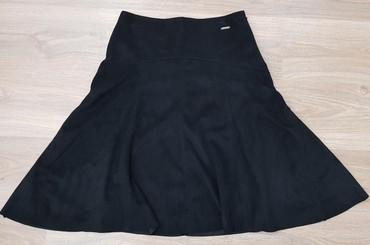 Стильная юбка .  материал спандекс /под замшу/.  Размер S-M. Корея