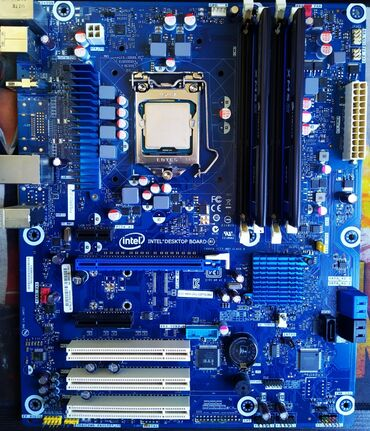 Продаю комплект на 1155 сокете.Материнская плата intel Z77 Процессор