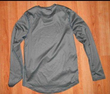 Majica aktivna vel.8-10dimenzije su sledece: sirina ramena 35