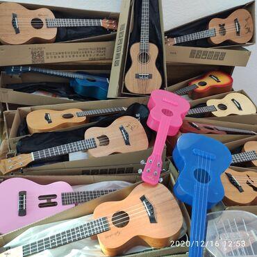 Музыкальные инструменты - Кыргызстан: Укулеле концерт красное темное светлое цветное дерево закаленное сте