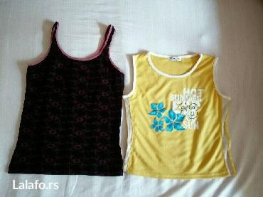 Dve majice s velicine.Pojedinacno cena zute majice 200, crne 150 - Beograd