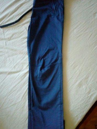 Nove elegantne plave pantalone.Prelep materjal.Vel 26. - Lazarevac