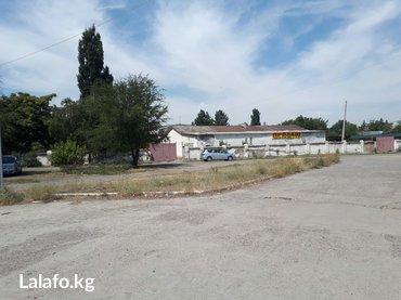 Участок 15 соток со складом(550m2) под бизнес  напротив городской боль в Токмак