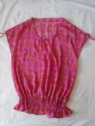 Prelepa tanana tunika/bluza. Etiketa sa veličinom je isečena ali - Belgrade