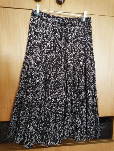 Duzina struk suknja - Srbija: Kvalitetna crno bela suknja duzina 70cm. struk je podesiv