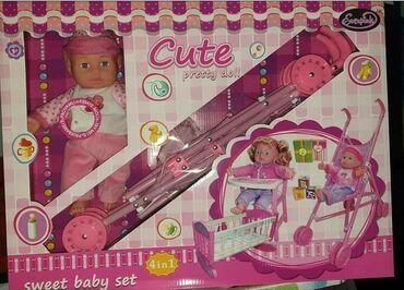 Barbie set - Crvenka: Set 4u1U setu dobijate bebu, kolica, krevetac i hranilicu.CENA