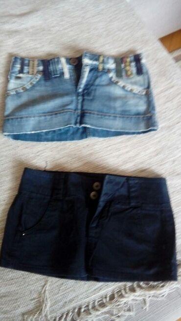 Zenske teksas suknje - Srbija: Zenske suknje,duzina crne bershka je 27cm,a druga teksas je 24cm