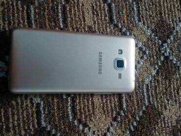 Ford grand c max - Кыргызстан: Б/у Samsung Galaxy J2 Prime 8 ГБ Желтый