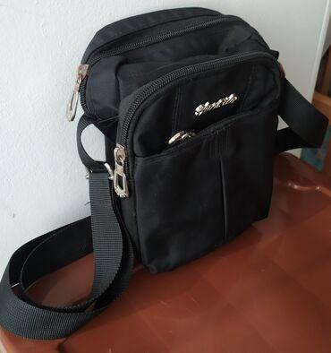 сумочку burberry в Кыргызстан: Продам сумочку. Уни. Подходит и для женщин и для мужчин. Хорошо для