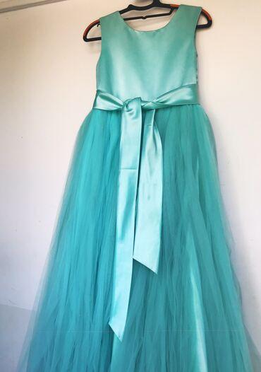 Продаём нарядное бирюзовое платье.В хорошем состоянии.Примерно 13-15