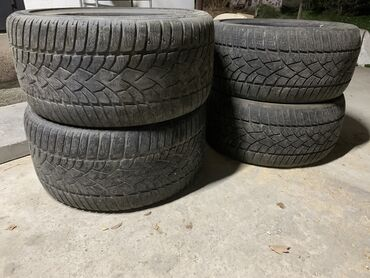 Продаю комплект зимних разношироких шин DUNLOP. перед: R18 255/35 за