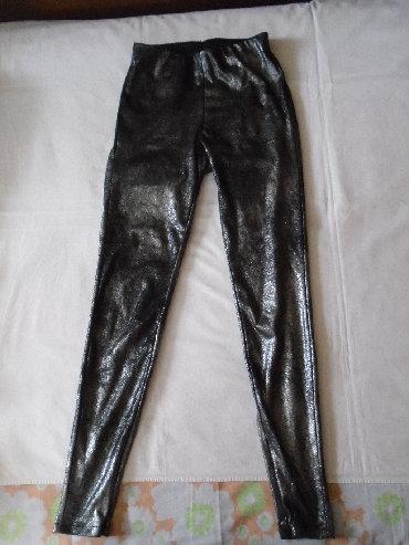 Radne pantalone - Srbija: Nove srebrnasto crne pantalone helanke Only, sa lepim odsjajem. Imaju