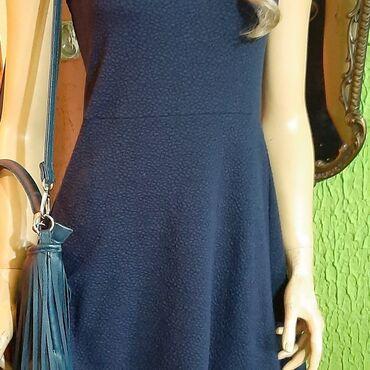 Teget plava prelepa lastexs haljinica sa cipkicom pri dnu,vel 40