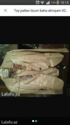 Bakı şəhərində Qadın paltarı troyka parıldayan materialdı  42razmer yupkası çox gözəl