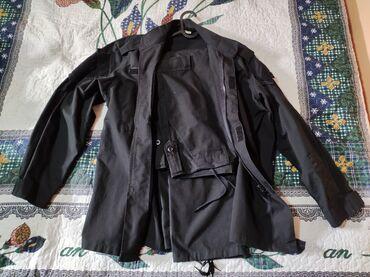 Продаю форму черного цвета, размер L-XL, карманы на плечах, нагрудные